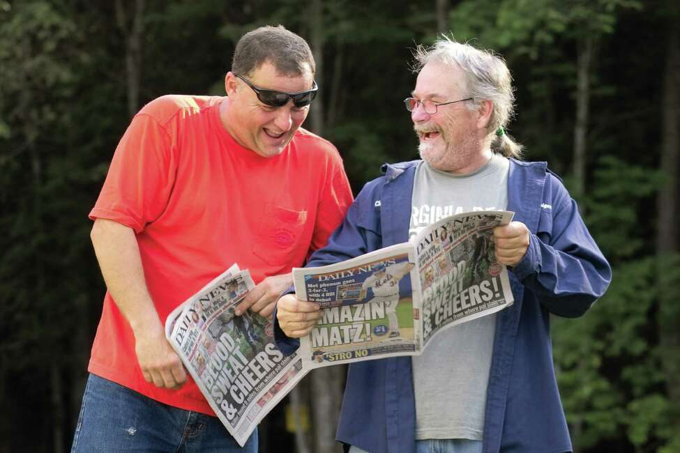 The New York Daily News' June 29 edition misidentified Eric Couture, left, and Charlie Coutu on the front page and website as the two escaped killers, Richard Matt and David Sweat from Clinton Correctional Facility. They share a light moment with the paper on July 26. (MANDATORY CREDIT: ©THOMAS PALMER) http://blog.timesunion.com/pictureprosecutor/