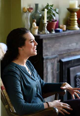 Danielle Valenti speaks to the Times Union about Huntington's disease at her home Friday morning  May 8, 2015 in Troy, N.Y.      (Skip Dickstein/Times Union) Photo: SKIP DICKSTEIN / 00031688A