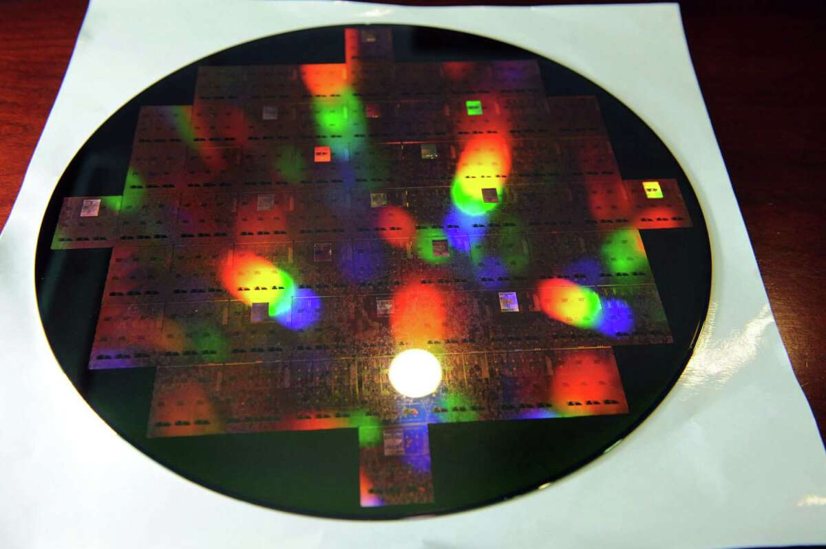 A 300mm wafer created using 3D-integration technology developed at SUNY Polytechnic to bond photonics chips to a base Si chip carrier or interposer on Thursday, July 30, 2015, at Albany Nanotech in Albany, N.Y. (Cindy Schultz / Times Union)