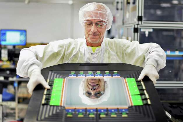 Fabrication technician Mark Skriptshak with a 31cm combo digital detector in a cleanroom at the digital x-ray detector factory at GE Healthcare Friday July 31, 2015 in Troy, NY. (John Carl D'Annibale / Times Union) Photo: John Carl D'Annibale / 10032850A