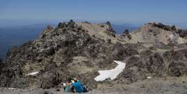 From the caldera rim of Lassen Peak, you can see past volcanic formations to distant Mount Shasta to the north -- about 100 miles away