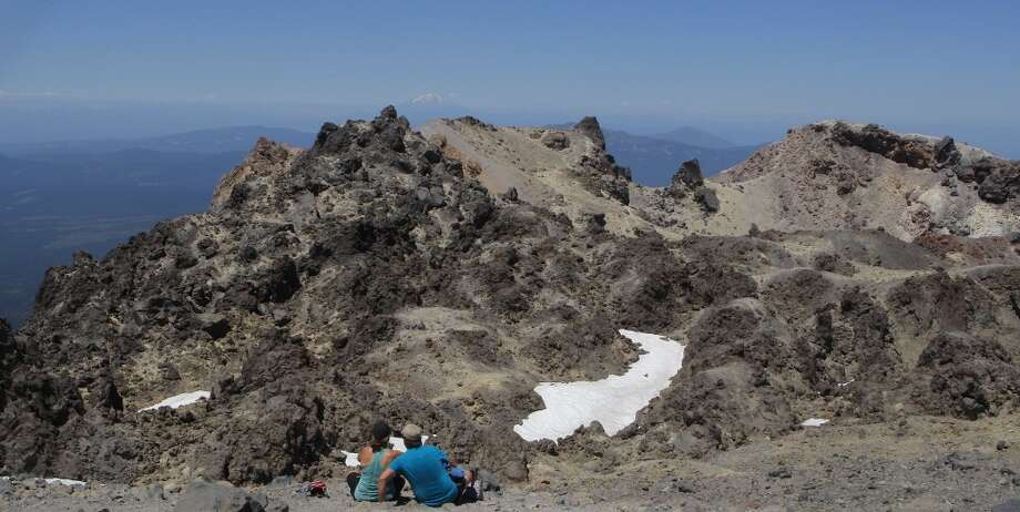 From the caldera rim of Lassen Peak, you can see past volcanic formations to distant Mount Shasta to the north -- about 100 miles away Photo: Tom Stienstra, The Chronicle