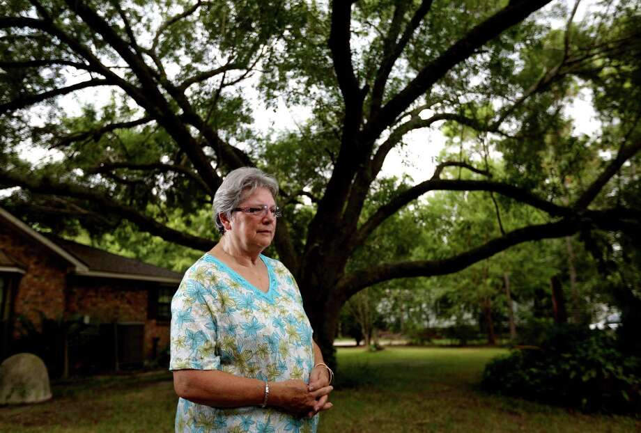 Mary Spencer reminisces about planting an Arizona ash tree in her yard some 45 years ago when she first moved to her home in northern Brazoria County to escape the city. Spencer fears her rural dream will be shattered by Pearland's annexation. Photo: Gary Coronado, Staff / © 2015 Houston Chronicle