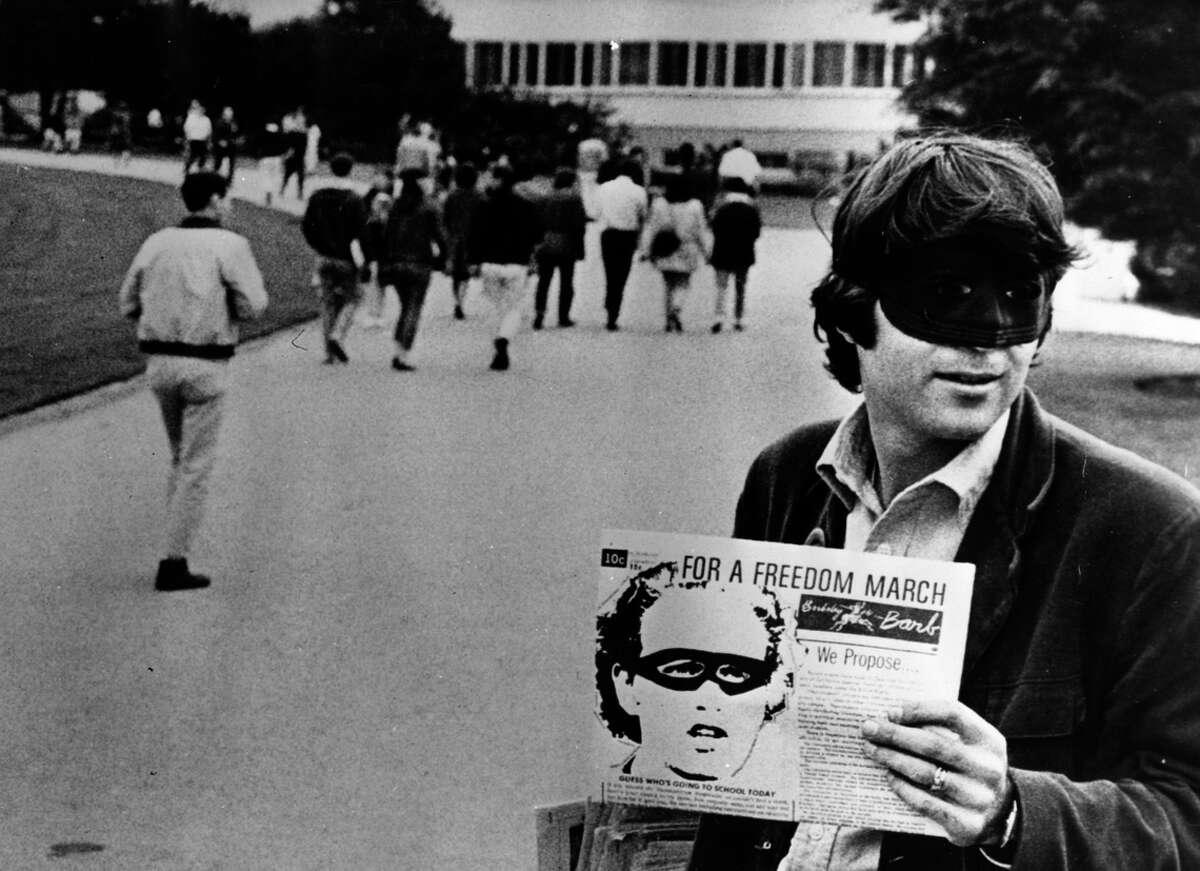 Left: UC Berkeley student Darrow Bishop sells copies of the Barb, wearing a Lone Ranger mask as part of a protest, on Feb. 7, 1967.