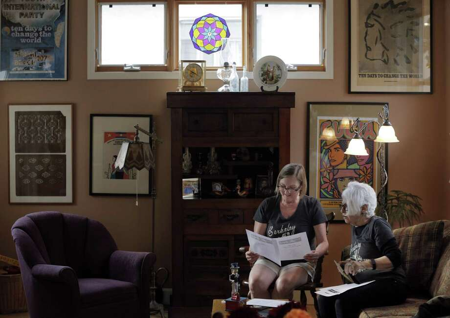 Diana Stephens, left, and Judy Gumbo, right, discuss plans for the 50th anniversary of the Berkeley Barb in Gumbo's apartment in Berkeley, Calif., on Thursday, July 30, 2015. The Berkeley Barb, a legendary underground newspaper in Berkeley will celebrate the 50th anniversary of its first issue, August 13, 1965, with a weekend of free activities including a concert. Photo: Carlos Avila Gonzalez / The Chronicle / ONLINE_YES