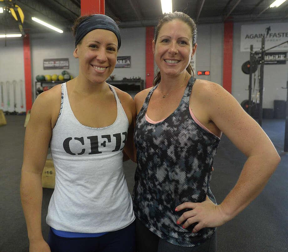 Elyse Dobrick and Michele Stone were at a triathlon held at Crossfit Beaumont Saturday morning. More than 20 participants took part in the event, which helped raise funds for the Giving Fields, a nearby community garden serving the needy. Athletes completed the equivalent of a 3K row on the club's machines, ran for 2 miles, then completed 100 burpee box jumps. Photo taken Saturday, August 1, 2015 Kim Brent/The Enterprise Photo: Kim Brent / Beaumont Enterprise