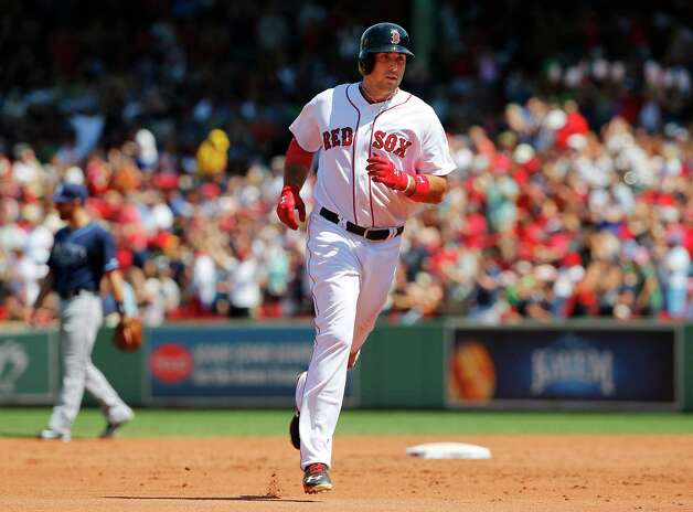 Boston Red Sox's Travis Shaw rounds the bases after his home run against the Tampa Bay Rays during the third inning of a baseball game at Fenway Park in Boston Saturday, Aug. 1, 2015. (AP Photo/Winslow Townson) ORG XMIT: BXF107 Photo: Winslow Townson / FR170221 AP