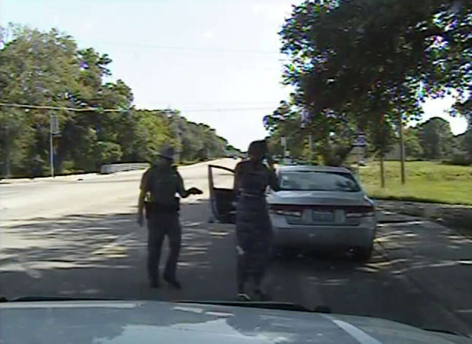 """FILE- In this July 10, 2015 file frame from dashcam video provided by the Texas Department of Public Safety, trooper Brian Encinia arrests Sandra Bland after she became combative during a routine traffic stop in Waller County, Texas. Encinia, a Texas trooper who arrested Bland after a confrontation that began with a traffic stop, had been cautioned about """"unprofessional conduct"""" in a 2014 incident while he was still a probationary trooper. (Texas Department of Public Safety via AP, File) Photo: Andy Alfaro, HOGP / Associated Press / Texas Department of Public Safet"""