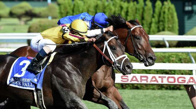 Rock Fall ridden by jockey Javier Castelano, left duels to the win with The Big Beast ridden by John Velazquez, right, in the 31st running of the Alfred G. Vanderbilt Saturday evening Aug. 1, 2015 at the Saratoga Race Course  in Saratoga Springs, N.Y.      (Skip Dickstein/Times Union) Photo: SKIP DICKSTEIN