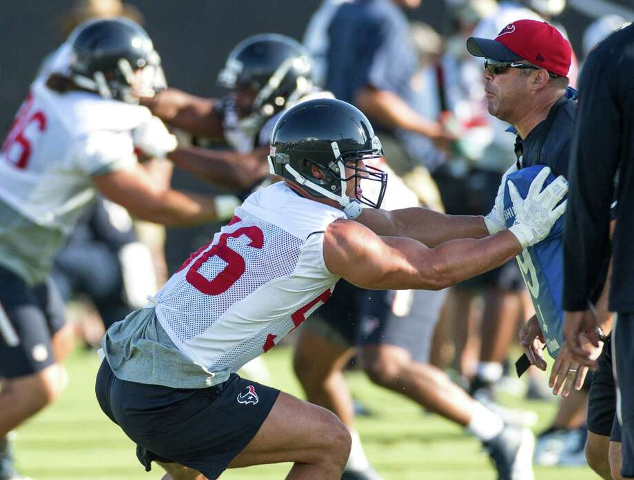 Houston Texans linebacker Brian Cushing (56) hits a blocking dummy during Texans training camp at the Methodist Training Center Saturday, Aug. 1, 2015, in Houston.  ( Brett Coomer / Houston Chronicle ) Photo: Brett Coomer, Staff / Houston Chronicle / © 2015 Houston Chronicle