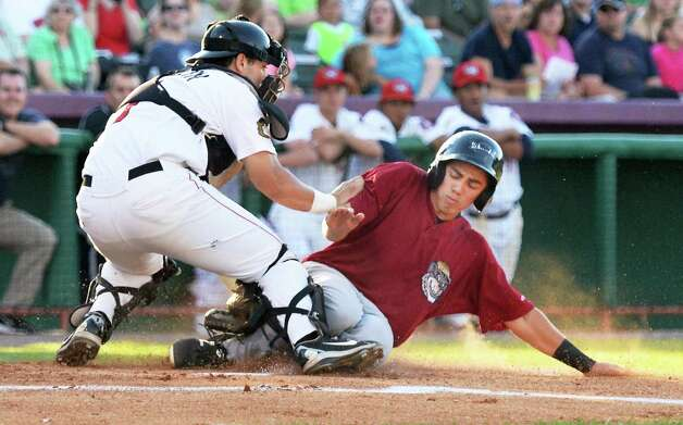 Mahoning Valley Scrappers' #11 Jodd Carter beats the throw home to Tri-City ValleyCats catcher Anthony Hermelyn to score during Saturday's game at Joe Bruno Stadium August 1, 2015 in Troy, NY.  (John Carl D'Annibale / Times Union) Photo: John Carl D'Annibale / 00032768A