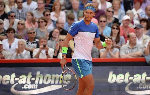 Spain's Rafael Nadal celebrates his win in the semifinal match against Andreas Seppi of Italy at the ATP tennis tournament in Hamburg, Germany,  Saturday Aug. 1, 2015. (Daniel Reinhardt/dpa via AP) ORG XMIT: XHBG111 Photo: Daniel Reinhardt / dpa