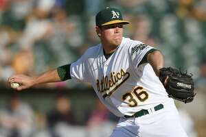 Aaron Brooks earns 1st win, rotation spot with A's - Photo