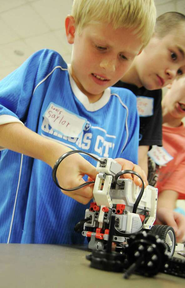 Louis Saylor,9, works on a robot at 4H Robo Camp held at the Texas A&M Agrilife Extension Office Saturday August 01, 2015. Photo: Dave Rossman, For The Chronicle / Freelalnce
