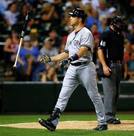 New York Yankees first baseman Mark Teixeira flips his bat after striking out in the during the eighth inning of a baseball game against the Chicago White Sox in Chicago, on Saturday, Aug. 1, 2015. (AP Photo/Jeff Haynes) ORG XMIT: CXS128 Photo: Jeff Haynes / FR171008 AP