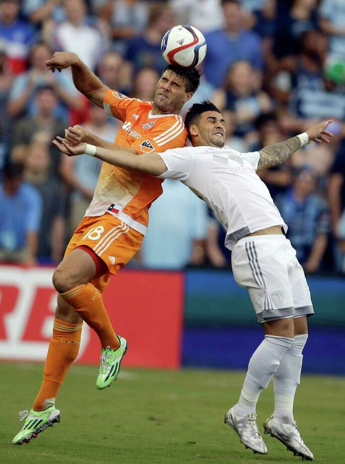The Dynamo's David Horst, left, soars head and shoulders above Sporting Kansas City's Dom Dwyer during the first half of Saturday night's match. Photo: Orlin Wagner, STF / AP