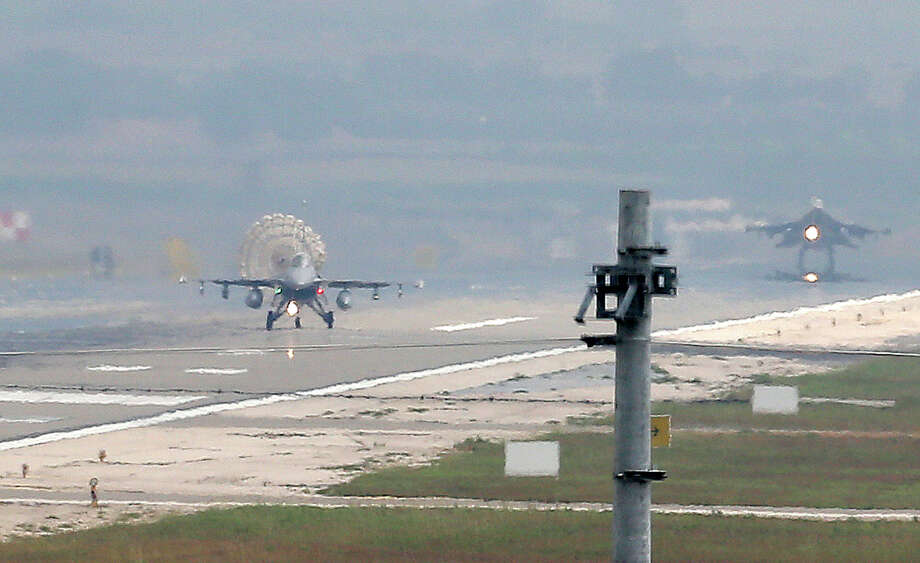 Turkish Air Force fighter planes land at Incirlik Air Base, on the outskirts of the city of Adana, southern Turkey, Thursday, July 30, 2015. After months of reluctance, Turkish warplanes last week started striking militant targets in Syria and agreed to allow the U.S. to launch its own strikes from Turkey's strategically located Incirlik Air Base. In a series of cross-border strikes, Turkey has not only targeted the IS group but also Kurdish fighters affiliated with forces battling IS in Syria and northern Iraq and Kurdistan Workers' Party, or PKK positions within Turkey. (AP Photo/Emrah Gurel) Photo: Emrah Gurel, STR / Associated Press / AP