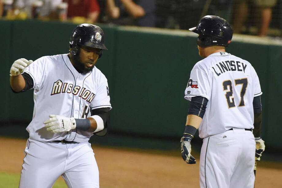 Yeison Asencio of the San Antonio Missions, left, is greeted by teammate Taylor Lindsey after hitting a sixth-inning home run against the Frisco RoughRiders during Texas League action at Wolff Stadium on Aug. 1, 2015. Photo: Billy Calzada /San Antonio Express-News / San Antonio Express-News