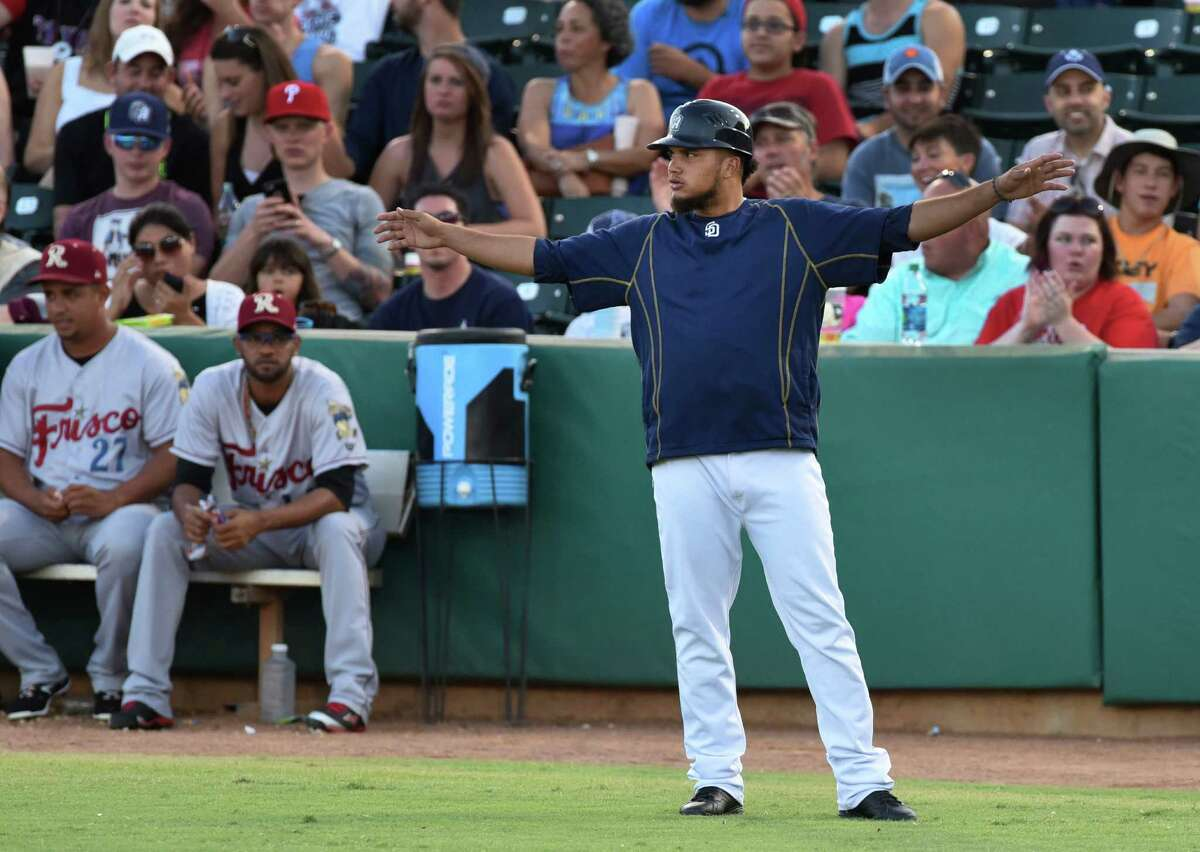 San Antonio Missions first base coach Diego Goris, who also plays shortstop on the team, gestures after a close play during Texas League action against Frisco at Wolff Stadium on Saturday, Aug. 1, 2015.