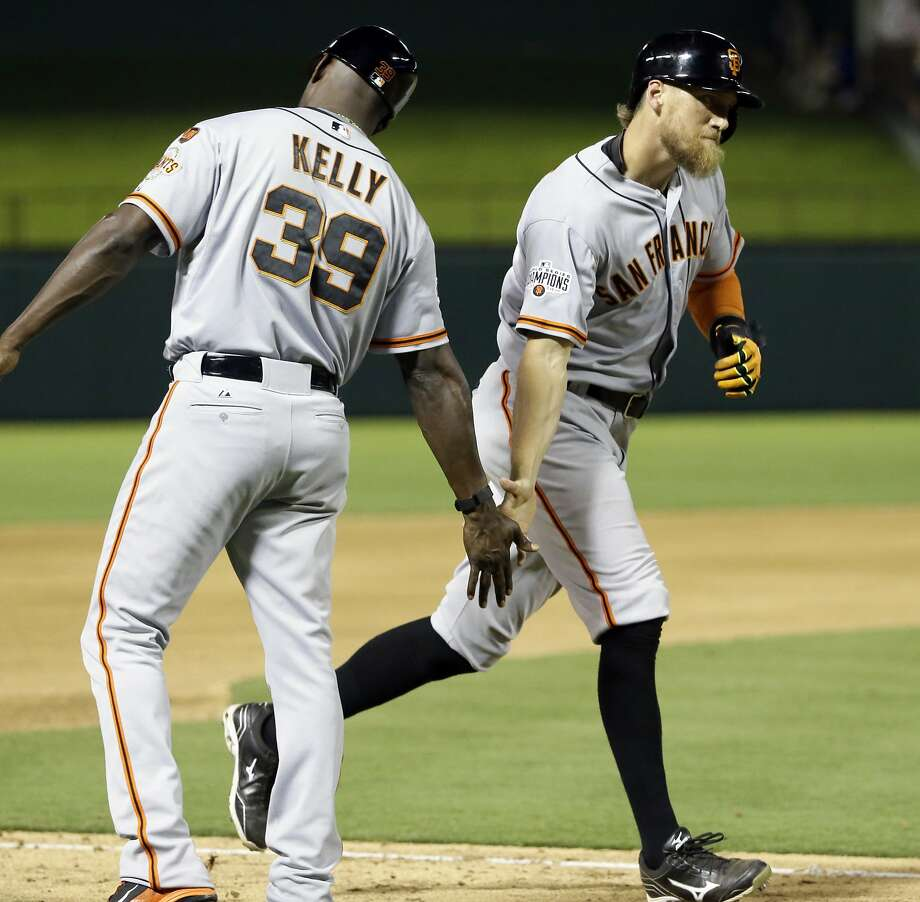 Third-base coach Roberto Kelly San Francisco Giants Hunter Pence, right, gets a greeted by third base coach Roberto Kelly (39) as he rounds the bases after hitting a solo home run in the 11th inning of a baseball game against the Texas Rangers in Arlington, Texas, Saturday, Aug. 1, 2015. The Giants won 9-7. (AP Photo/LM Otero) Photo: LM Otero, Associated Press