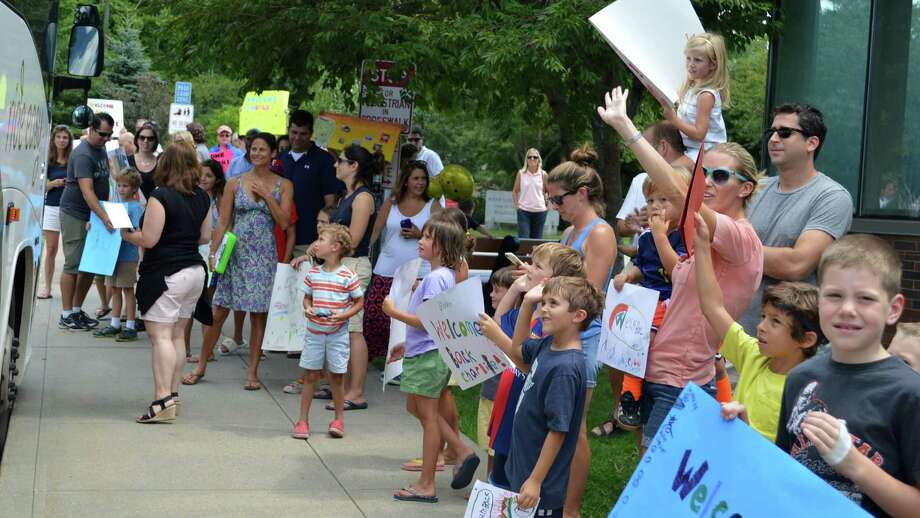 Host families welcome a busload of Fresh Air Fund visitors Saturday. Photo: Jarret Liotta / For Hearst Connecticut Media / Westport News