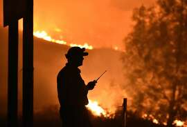 A Cal Fire firefighter keeps an eye on the Rocky fire near Clear Lake, California on August 2, 2015. The fire has charred more than 27,000 acres, and is currently only 5% contained. AFP PHOTO/JOSH EDELSONJosh Edelson/AFP/Getty Images