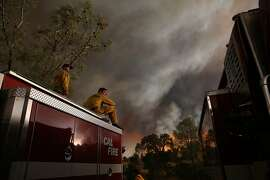 CLEARLAKE, CA - AUGUST 01:  Cal Fire firefighters monitor the progress of the Rocky Fire on August 1, 2015 near Clearlake, California. Over 1,900 firefighters are battling the Rocky Fire that burned over 22,000 acres since it started on Wednesday afternoon. The fire is currently five percent contained and has destroyed at least 14 homes.  (Photo by Justin Sullivan/Getty Images)
