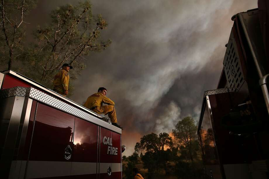Cal Fire firefighters monitor the progress of the Rocky Fire on August 1, 2015 near Clearlake, California. Over 1,900 firefighters are battling the Rocky Fire that burned over 22,000 acres since it started on Wednesday afternoon. The fire is currently five percent contained and has destroyed at least 14 homes. Photo: Justin Sullivan, Getty Images