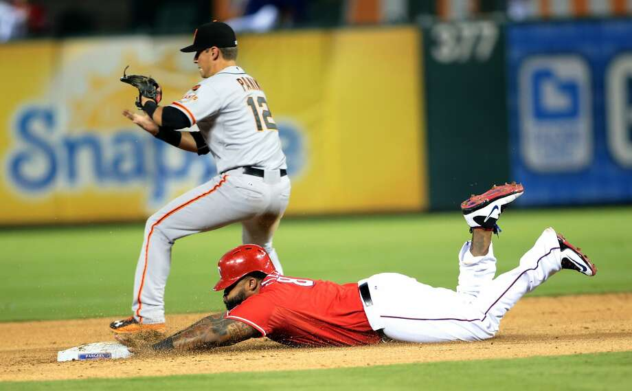 ARLINGTON, TX - AUGUST 1: Prince Fielder #84 of the Texas Rangers slides in to second base in the seventh inning against Joe Panik #12 of the San Francisco Giants at Globe Life Park in Arlington on August 1, 2015 in Arlington, Texas.  (Photo by Rick Yeatts/Getty Images) Photo: Rick Yeatts, Getty Images