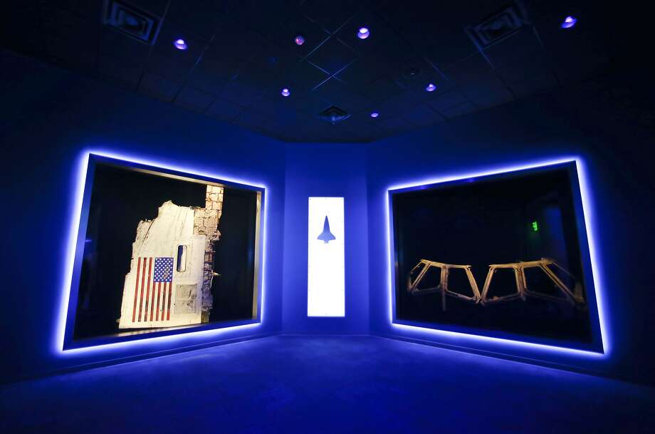 This Tuesday, July 21, 2015 photo shows a side body panel of space shuttle Challenger, left, and the cockpit widows of Columbia, right, displayed at the Forever Remembered exhibit and memorial for the astronauts that perished on the two shuttles at the Kennedy Space Center Visitor Complex, in Cape Canaveral, Fla. (AP Photo/John Raoux) Photo: John Raoux, Associated Press