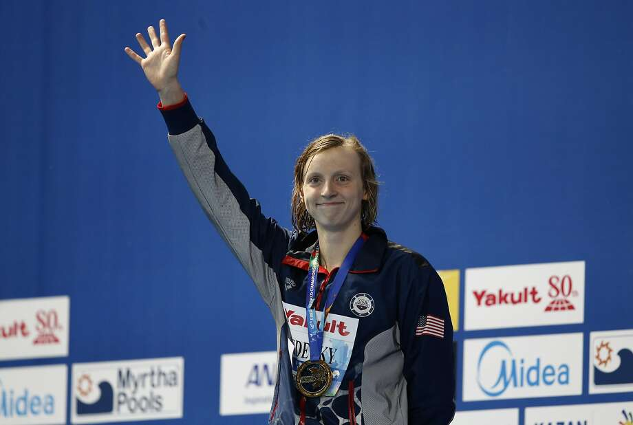 Katie Ledecky celebrates her 400-meter freestyle gold at the world swimming championships in Kazan, Russia, Sunday, Aug. 2, 2015. (AP Photo/Sergei Grits) Photo: Sergei Grits, Associated Press