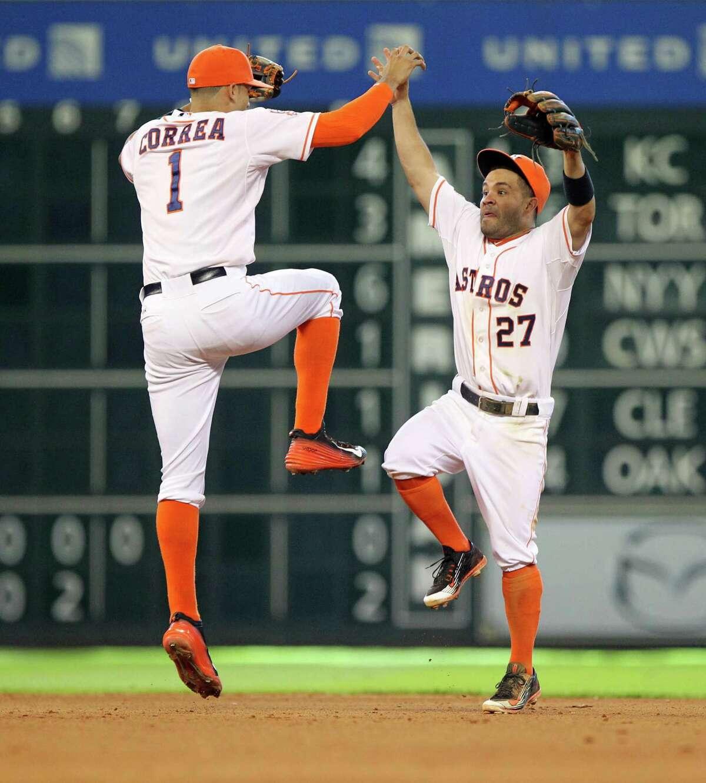 Shortstop Carlos Correa (left) and second baseman Jose Altuve celebrate the Astros' victory over the Diamondbacks on Sunday. C4