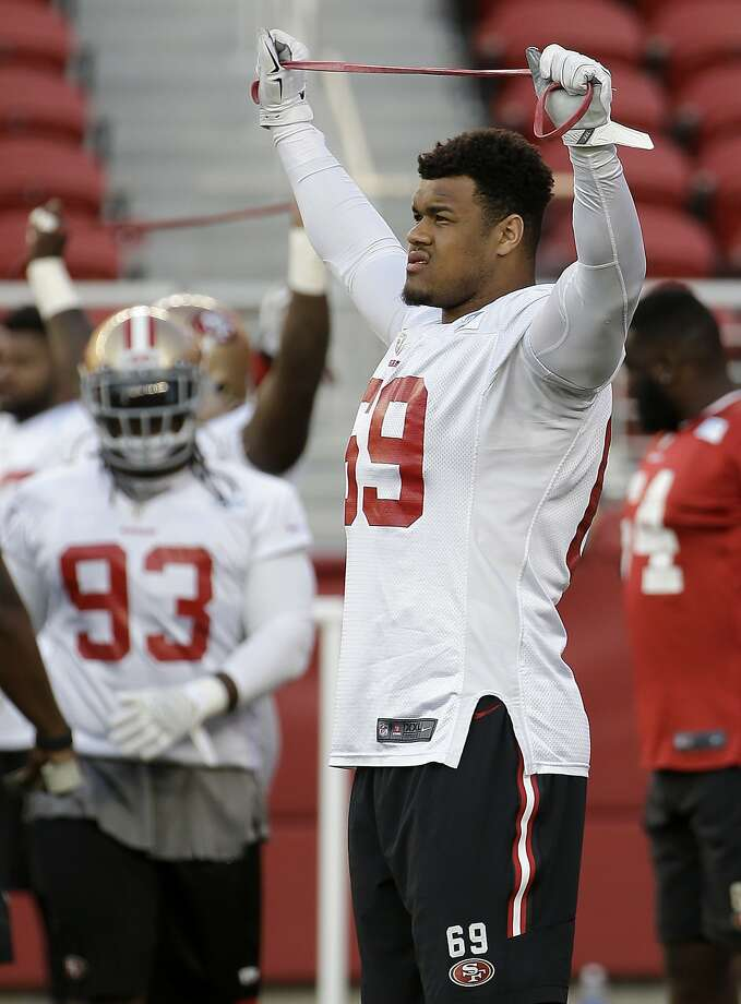 Defensive lineman Arik Armstead, who was taken 17th overall in the draft, stretches at the 49ers' facility in Santa Clara. Photo: Jeff Chiu, Associated Press