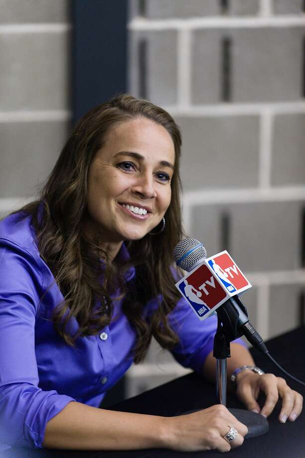 WNBA star Becky Hammon takes questions from the media at the San Antonio Spurs practice facility after being introduced as an assistant coach with the team on Tuesday, Aug. 5, 2014 in San Antonio. The San Antonio Spurs hired WNBA star Becky Hammon on Tuesday, making her the first full-time, paid female assistant on an NBA coaching staff.  (AP Photo/Bahram Mark Sobhani) Photo: Bahram Mark Sobhani, Associated Press
