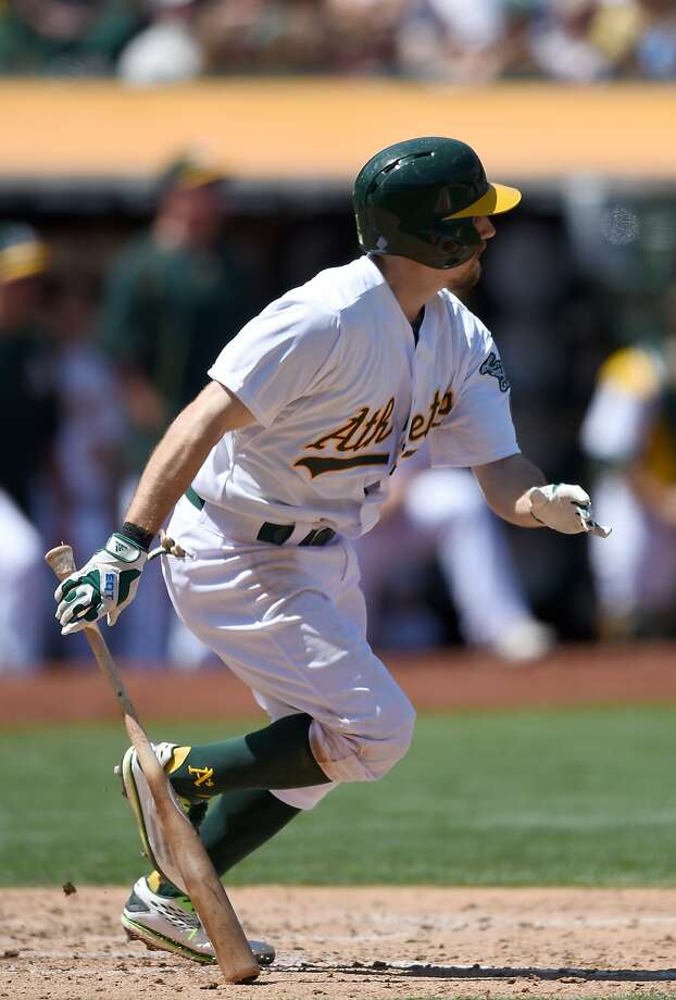 Billy Burns of the Oakland Athletics hits an RBI single scoring Eric Sogard #28 against the Cleveland Indians in the bottom of the fifth inning at O.co Coliseum on August 2, 2015 in Oakland, California. Photo: Thearon W. Henderson, Getty Images