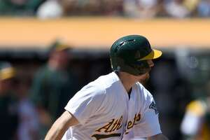 Mark Canha's double gives A's win over Cleveland in 10th - Photo