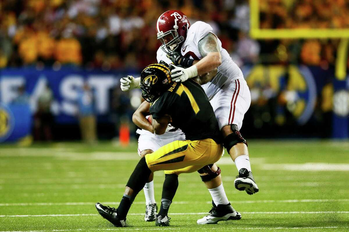 ATLANTA, GA - DECEMBER 06: Austin Shepherd #79 of the Alabama Crimson Tide blocks Maty Mauk #7 of the Missouri Tigers in the second quarter of the SEC Championship game at the Georgia Dome on December 6, 2014 in Atlanta, Georgia. (Photo by Kevin C. Cox/Getty Images)