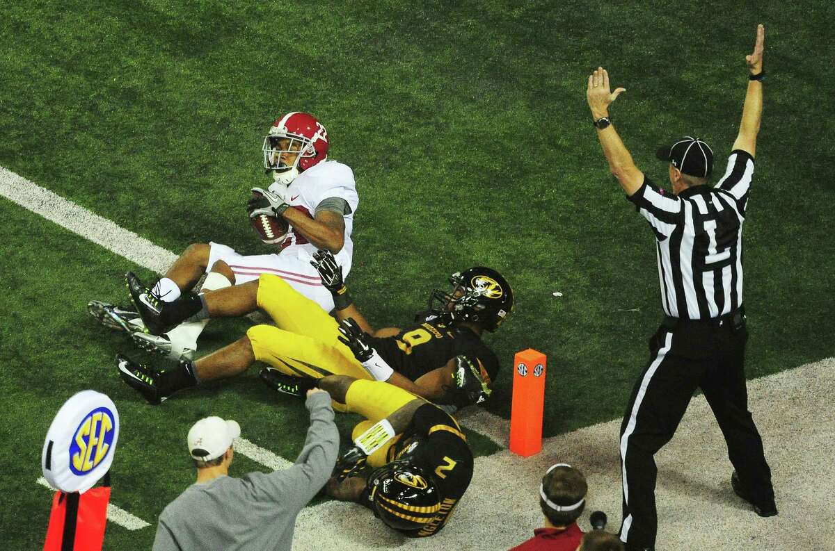 ATLANTA, GA - DECEMBER 06: Christion Jones #22 of the Alabama Crimson Tide scores a touchdown against Braylon Webb #9 and Duron Singleton #2 of the Missouri Tigers in the fourth quarter of the SEC Championship game at the Georgia Dome on December 6, 2014 in Atlanta, Georgia. (Photo by Scott Cunningham/Getty Images)