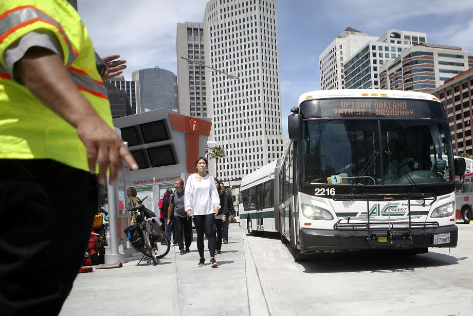 Bay area residents line up at the temporary Transbay Terminal on Sunday, August 2, 2015.  Free shuttle service was offered in response to BART's shutdown during the weekend. Photo: Cameron Robert, The Chronicle