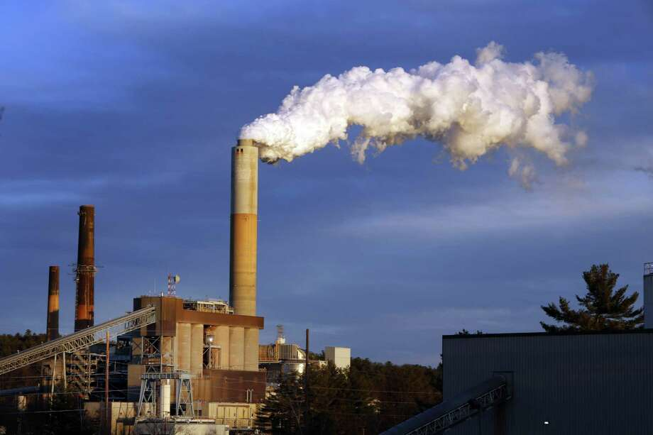A plume of steam billows from the coal-fired Merrimack Station in Bow, N.H. The U.S. is already on track to cut emissions by 27 percent in 2030, according to Environmental Protection Agency calculations. Photo: Associated Press File Photo / AP
