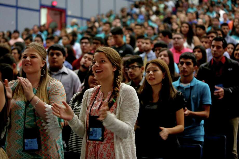 Kaylee Leonard, left, of Plantersville, and Marisa Creixell, of Houston, attend the closing Mass presided over Daniel Nicholas Cardinal DiNardo, Catholic Archbishop of Galveston-Houston, at the Archdiocese of Galveston-Houston's 59th Archdiocesan Youth Conference at the George R. Brown Convention Center Sunday, Aug. 2, 2015, in Houston, Texas. The conference was attended by over 3100 youth. Photo: Gary Coronado, Houston Chronicle / © 2015 Houston Chronicle
