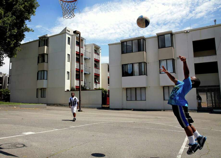 Trevon Jones (left) and Ezon Jones play ball at the basketball court on the pre-renovation Buchanan Street Mall. Photo: Connor Radnovich / Connor Radnovich / The Chronicle / ONLINE_YES