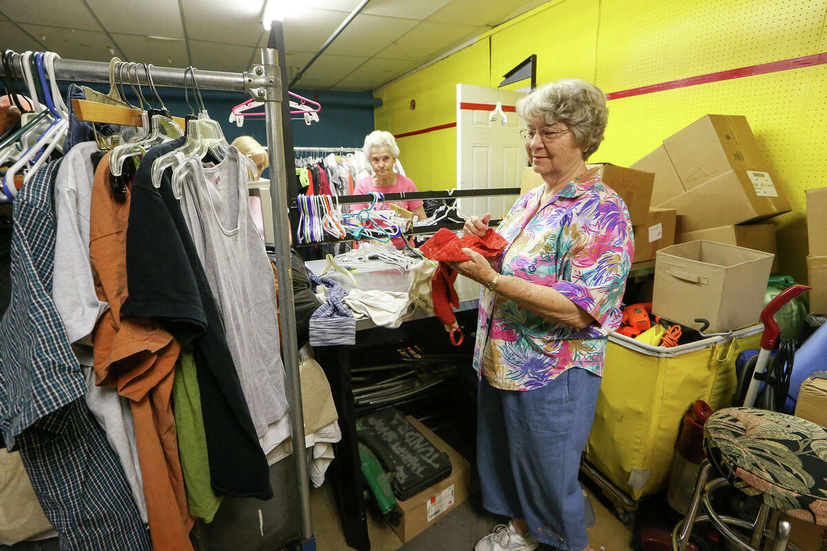 Martha Clark (from right), Catherine Hohmann and Irene Lamprecht sort donated clothing at the Roy Maas Youth Alternatives Thrift Shop on Monday, July 27, 2015.