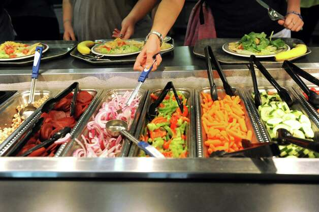 Campers help themselves to the salad bar during the Wellspring New York camp on Wednesday, July 15, 2015, at Union College in Schenectady, N.Y. (Cindy Schultz / Times Union) Photo: Cindy Schultz / 00032633A