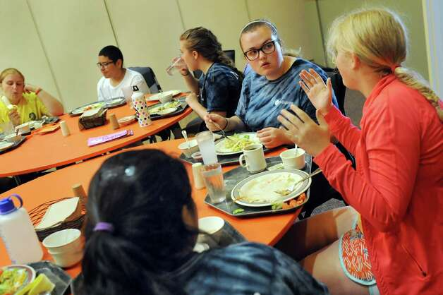 Campers chat at lunch during the Wellspring New York camp on Wednesday, July 15, 2015, at Union College in Schenectady, N.Y. (Cindy Schultz / Times Union) Photo: Cindy Schultz / 00032633A