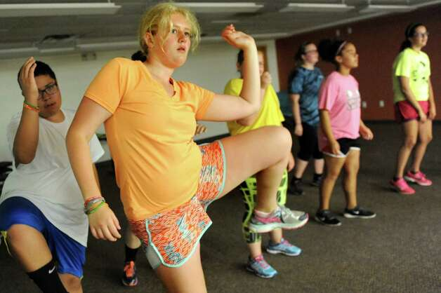 Elora Griswold, 14, of Cumberland, Maine, center, leads campers in exercises during the Wellspring New York camp on Wednesday, July 15, 2015, at Union College in Schenectady, N.Y. (Cindy Schultz / Times Union) Photo: Cindy Schultz / 00032633A