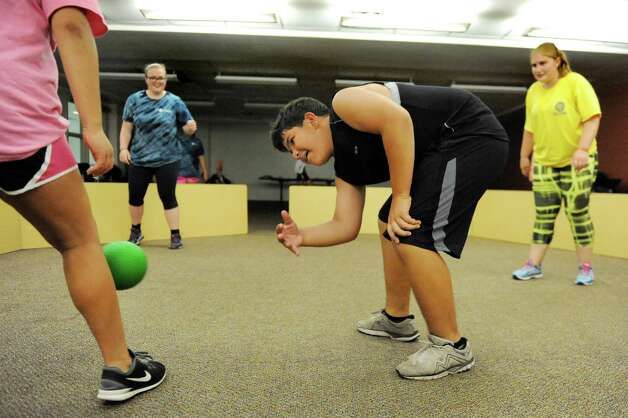 Hector Guerra, 13, of Bucks County, Penn., center, takes charge in a game of Gaga during the Wellspring New York camp on Wednesday, July 15, 2015, at Union College in Schenectady, N.Y. (Cindy Schultz / Times Union) Photo: Cindy Schultz / 00032633A