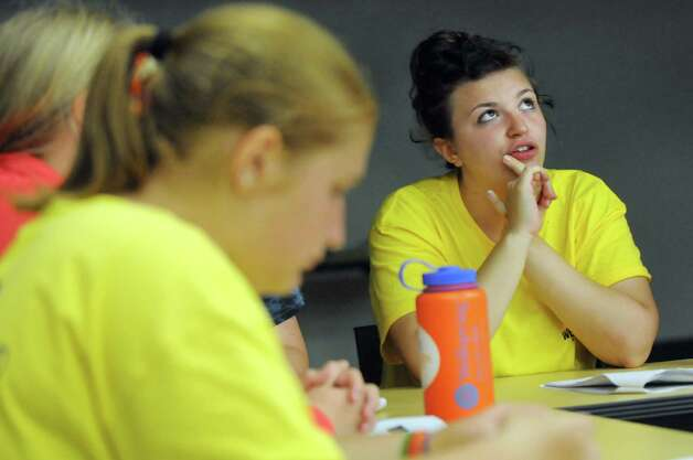 Sakshi Goyal, 14, of Long Island, right, considers her answer when campers are quizzed about going out to eat during the Wellspring New York camp on Wednesday, July 15, 2015, at Union College in Schenectady, N.Y. (Cindy Schultz / Times Union) Photo: Cindy Schultz / 00032633A