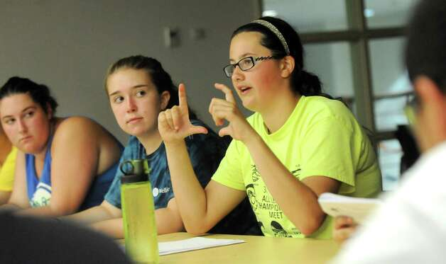 Sandy Sparks, 13, of Lockport, N.Y., right, talks about how to handle situations when dining out during the Wellspring New York camp on Wednesday, July 15, 2015, at Union College in Schenectady, N.Y. (Cindy Schultz / Times Union) Photo: Cindy Schultz / 00032633A