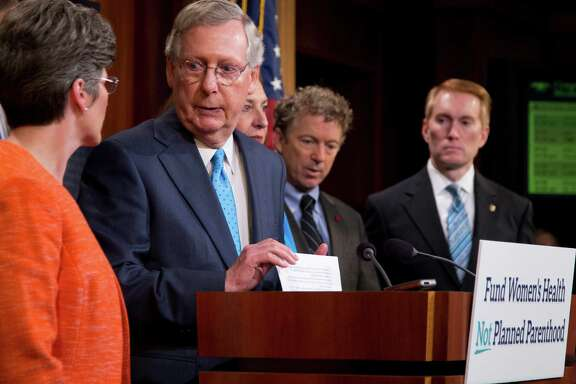 Senate Majority Leader Mitch McConnell of Ky., joined by, from left, Sen. John Thune, R-S.D., Sen. Joni Ernst, R-Iowa, Republican presidential candidate, Sen. Rand Paul, R-Ky., and Sen. James Lankford, R-Okla., speaks during a news conference on Capitol Hill in Washington, Wednesday,July 29, 2015, to discuss Planned Parenthood.   (AP Photo/Manuel Balce Ceneta)